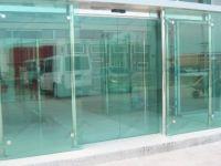 фото стеклянные входные двери для торгового дома