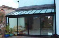 фото двухпольная стеклянная входная группа для загородного дома