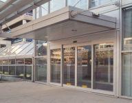 фото автоматические раздвижные стеклянные двери для офиса