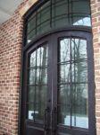 фото металлические кованые двухпальные двери со стеклом